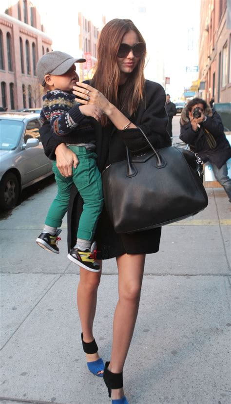 Miranda Kerr carried a black Givenchy bag while out in NYC